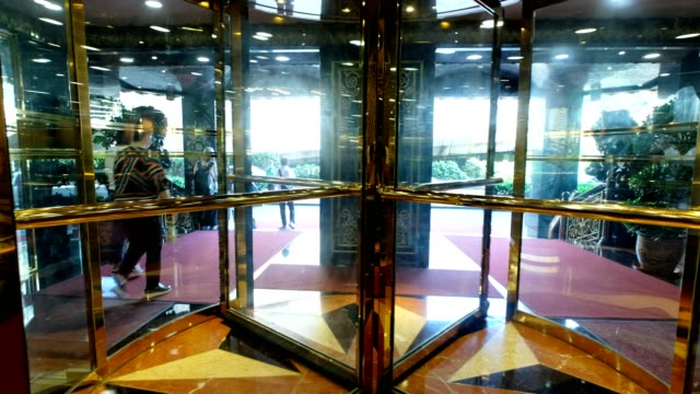Luxury glass modern door automatic rotating at hotel Luxury glass modern door automatic rotating at hotel lobby stock videos & royalty-free footage