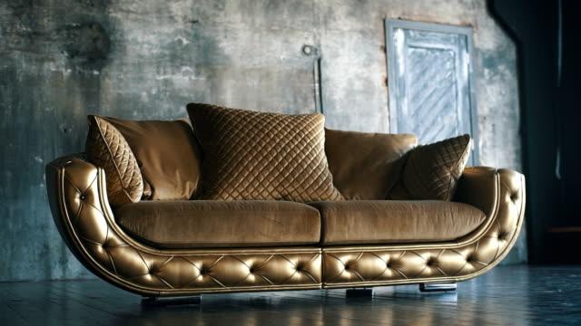 lyxiga golden soffa på loft bakgrund - läder bildbanksvideor och videomaterial från bakom kulisserna