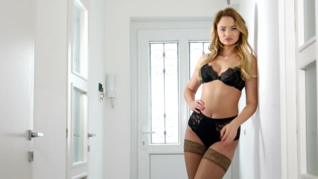 luxury lingerie woman in hallway of european flat - cleavage stock videos & royalty-free footage