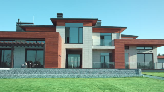 vídeos de stock e filmes b-roll de luxury modern villa with garden. private modern house view. - driveway, no people