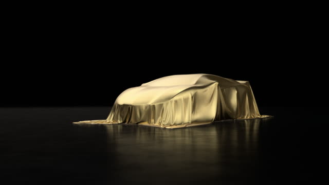 Luxury sports car covered with gold fabric. Luxury sports car covered with gold fabric. luxury car stock videos & royalty-free footage