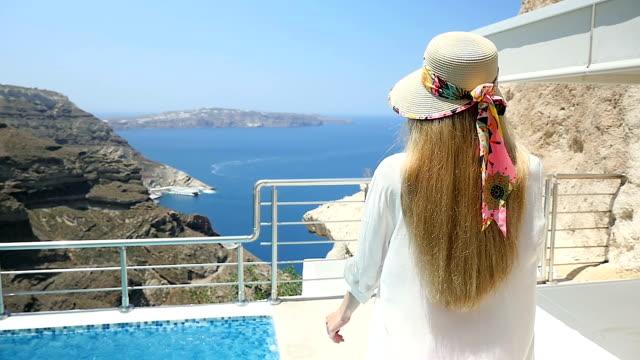 Luxury vacations & woman walking on balcony video
