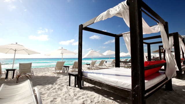 Luxury wooden lounge bed on a beautiful beach video