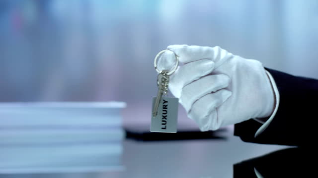 luxury written on keychain receptionist hand demonstrating, hotel rest vacations - key ring stock videos & royalty-free footage