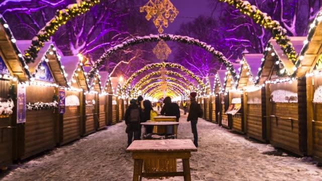 lviv christmas market night time lapse 1080p - barocco video stock e b–roll