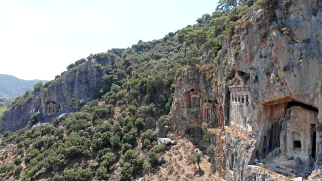 Lycian rock tombs in Dalyan Famous Lycian Rock Tombs of ancient Caunos city, Dalyan, Turkey aegean turkey stock videos & royalty-free footage