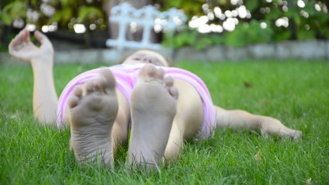 hd: lying on a meadow - stock video - ligga på mage bildbanksvideor och videomaterial från bakom kulisserna