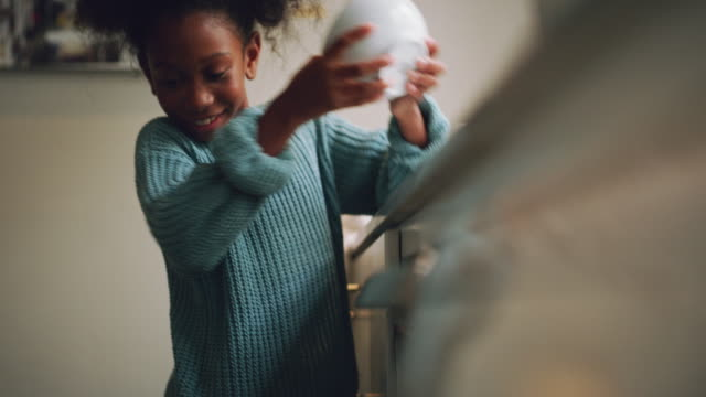 I'm a big girl now 4k video footage of an adorable little girl using a dish washing machine to do the dishes at home chores stock videos & royalty-free footage
