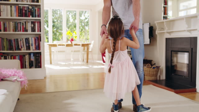 I'm proud of you my little girl 4k video footage of a handsome young Dad dancing with his daughter at home living room stock videos & royalty-free footage