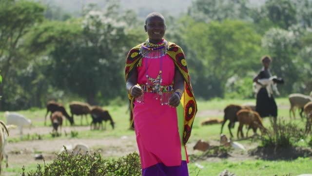 Maasai woman smiling and dancing