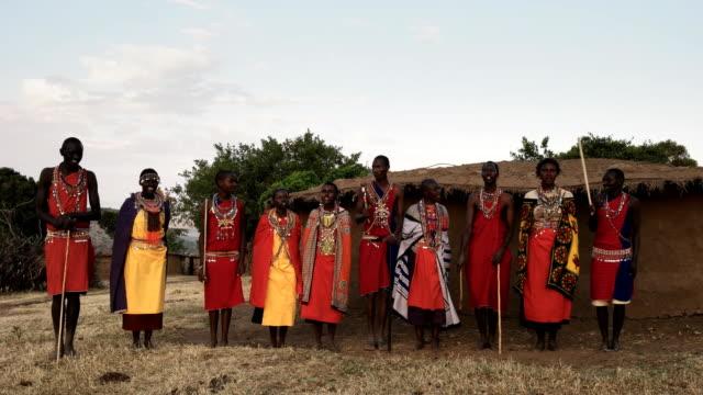maasai women and men sing then dance in pairs video