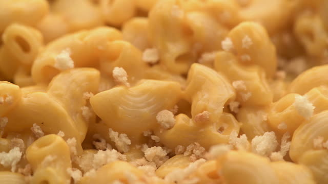 Mac and Cheese Macro Slider with Toasted Panko  Topping Clip with slider action of mac & cheese with toasted pancko dropping onto food. cheese stock videos & royalty-free footage