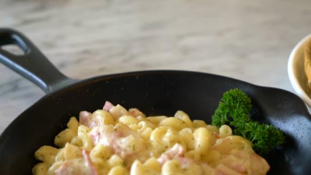 macaroni with ham and cheese macaroni with ham and cheese macaroni stock videos & royalty-free footage