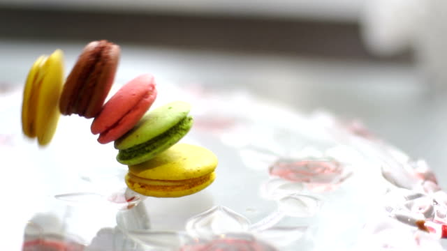macaroon cookies falls on the plate - french food stock videos and b-roll footage