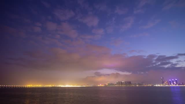 macau city bay sunset time zhuhai night illumination coastline panorama timelapse 4k china - zhuhai video stock e b–roll