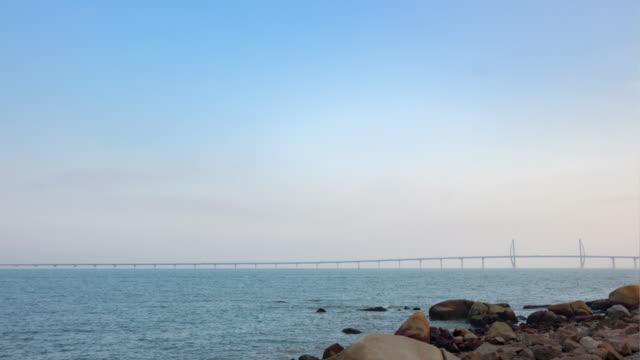 macau city day time famous traffic bridge panorama timelapse 4k china - zhuhai video stock e b–roll