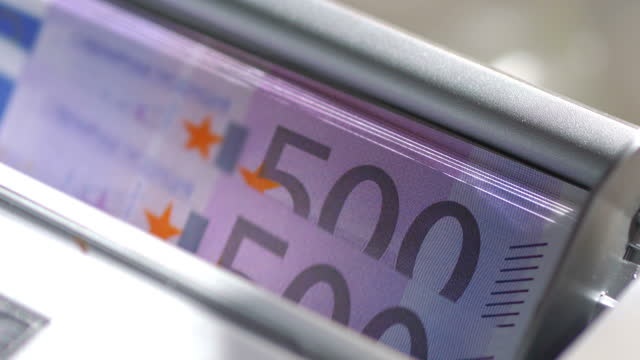 Machine counter automatic calculates a large amount of Euro banknotes in 4K Slow motion 60fps Machine counter automatic calculates a large amount of Euro banknotes in 4K Slow motion 60fps european union currency stock videos & royalty-free footage