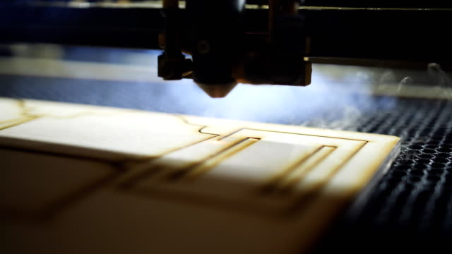 CNC machine cutting wood with a laser. CNC machine at work. Close-up.