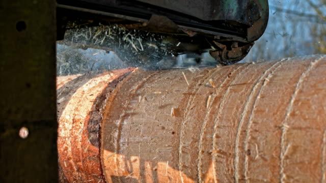 SLO MO Machine debarking a log video