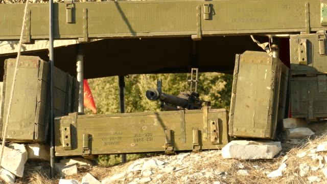machine gun point equipment of boxes of ammunition video