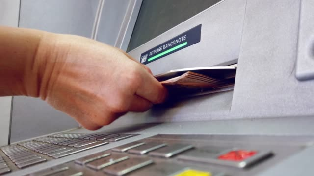 """ATM machine hand taking cash bank withdrawal service with the italian text """"ritirare banconote"""" meaning take cash ATM machine hand taking cash bank withdrawal service with the italian text """"ritirare banconote"""" meaning take cash banks and atms stock videos & royalty-free footage"""