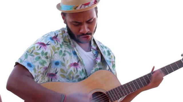 Macho plays the guitar. video