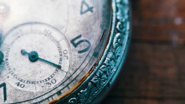 macro closeup of an vintage clock - timeline стоковые видео и кадры b-roll