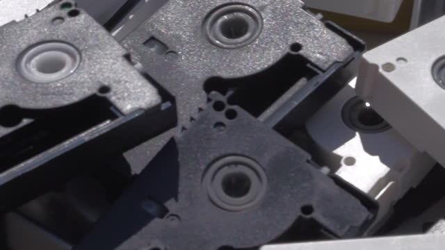 Macro detail of a pile of old digital videotapes video