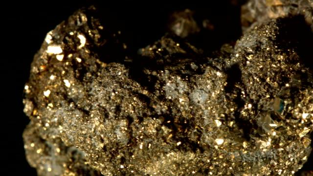 Macro dolly: pyrite on black video