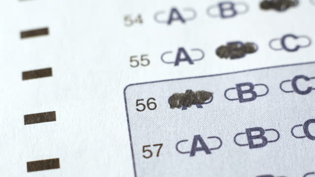 stockvideo's en b-roll-footage met macro flyover of scantron test - examen