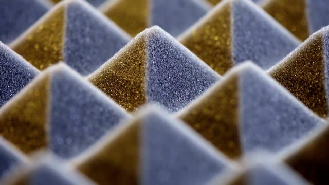 macro of acoustic foam panel background - poliuretano polimero video stock e b–roll