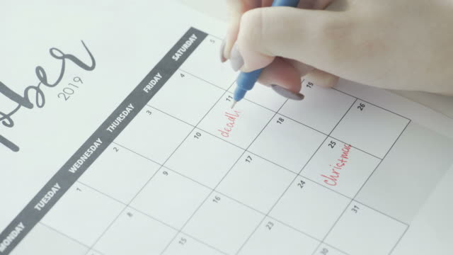 Macro of the hand writing a word deadline in the schedule under the date of 11 Macro of the hand writing a word deadline in the schedule under the date of 11 FullHD personal organizer stock videos & royalty-free footage