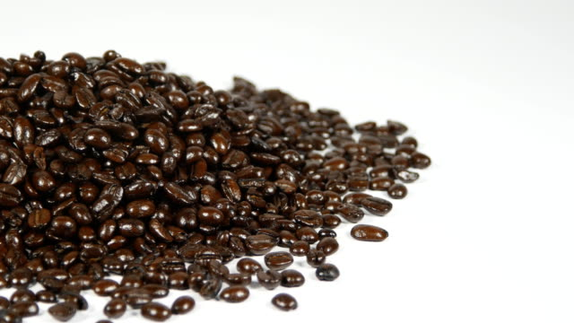 Macro panning shot of coffee beans on the table video