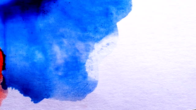 Macro photography. Drawing paints on paper. video