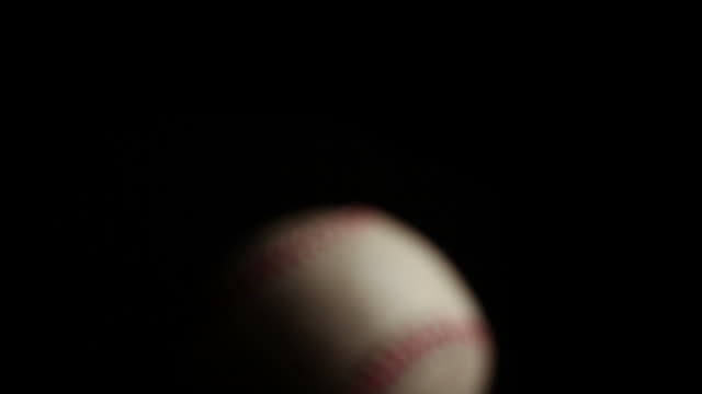 Macro push into focus on a baseball  focus on foreground stock videos & royalty-free footage
