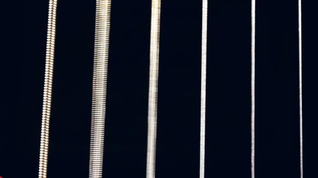 vídeos y material grabado en eventos de stock de macro juego de guitarra de cuerda - cuerda