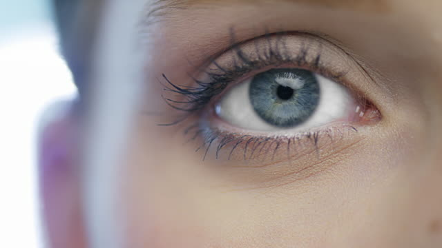 Macro shoot of opening blue eye with natural make-up video