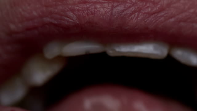 macro shot of a large mouth shouting - lingua bocca video stock e b–roll