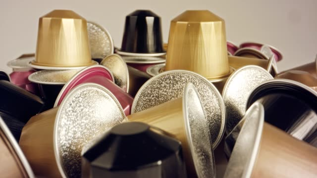Macro shot of espresso capsules in various colors and flavors