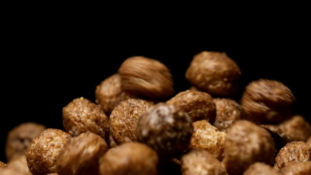 slow motion: macro shot of falling of chocolate balls on a heap - chef triste video stock e b–roll