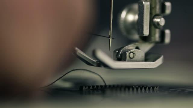 Macro shot of man working with sewing machine video