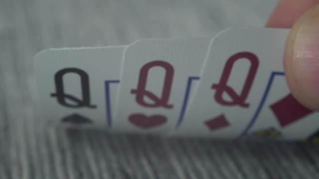 vídeos de stock e filmes b-roll de macro shot of playing cards on a casino table - três objetos