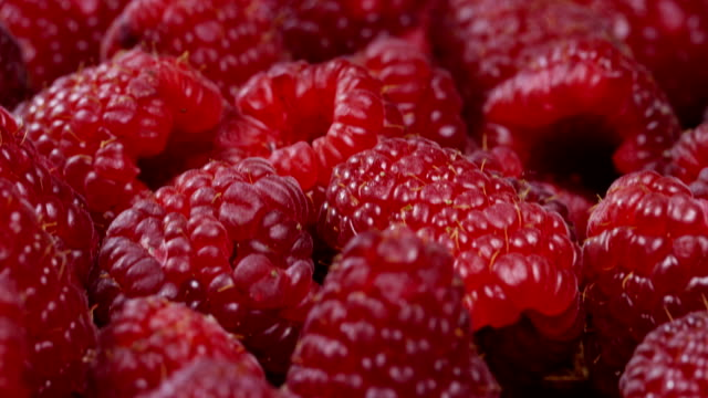 Macro shot of raspberries, fruit often used for jams, syrups and jellies. Raspberries contains a lot of vitamin c and diuretic functions. Fruit concept, juices and jams and cakes.