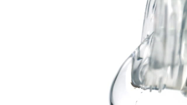 Macro Shot of Water Pouring from Plastic Bottle video