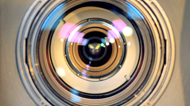 A macro view of a working camera lens. A detailed macro view on a focusing video camera lens. camera photographic equipment stock videos & royalty-free footage