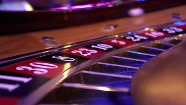 Macro view on a Roulette Wheel in a casino - camera fixed on wheel video