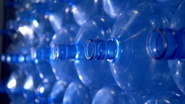 Macro view on necks of empty water cooler bottles. video