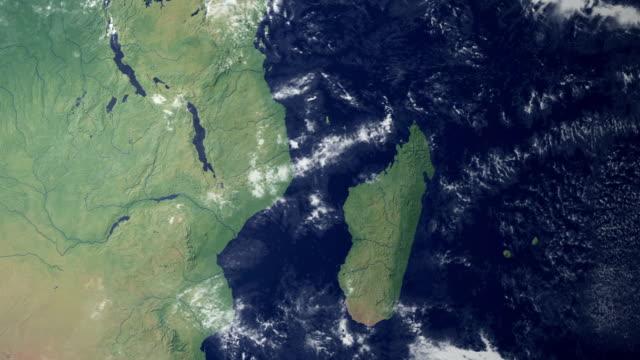madagascar pops up after earth zoom  (with alpha matte) - morondava bildbanksvideor och videomaterial från bakom kulisserna