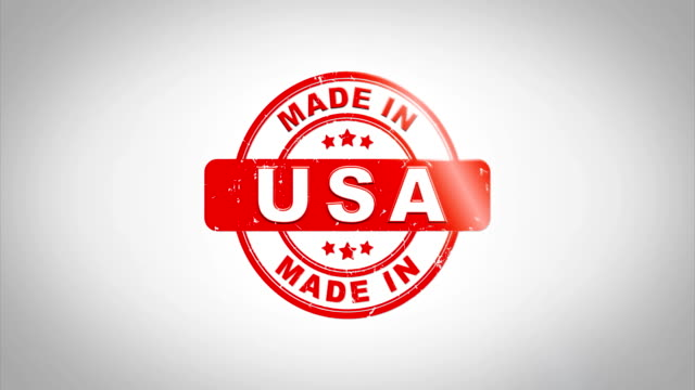 vídeos de stock e filmes b-roll de made in usa signed stamping text wooden stamp animation. red ink on clean white paper surface background with green matte background included. - fazer
