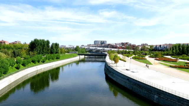 Madrid river landmark of green water river Manzanares at garden park forest cityscape and metal bridge in Madrid city Spain Europe hd format stock videos & royalty-free footage